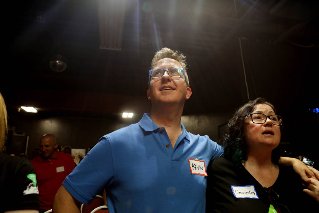 Member Kevin Bagger, left, and Lead organizer of the local chapter of Sunday Assembly Cassandra Cicone sing during their monthly gathering at the Center for Science and Wonder in Las Vegas, June 4 ...