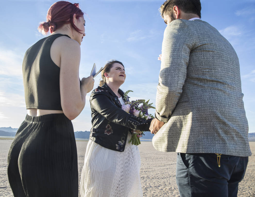Victoria Hogan, left, officiates the popup wedding of Shannon Bray, middle, and Joe Brown on Tuesday, June 6, 2017, at El Dorado Dry Lake Bed, outside Boulder City. Hogan is the founder of Flora P ...