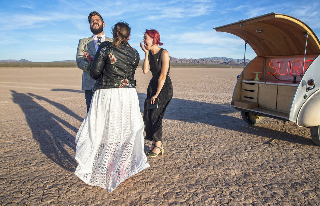 Victoria Hogan, right, officiates the popup wedding of Shannon Bray, middle, and Joe Brown on Tuesday, June 6, 2017, at El Dorado Dry Lake Bed, outside Boulder City. Hogan is the founder of Flora  ...