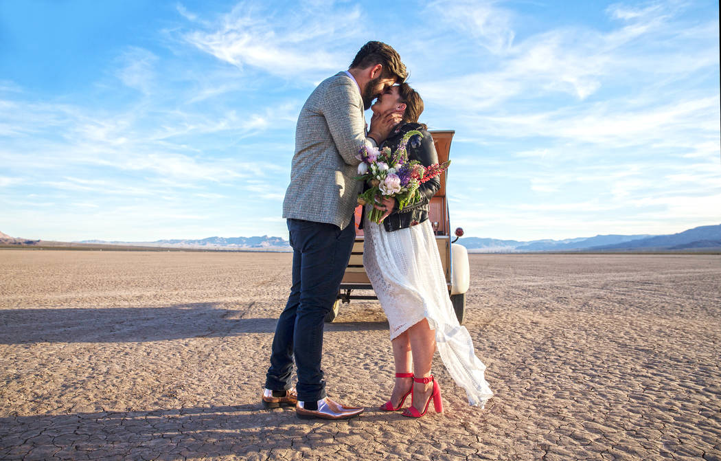 Joe Brown, left, kisses his new wife Shannon Bray at the conclusion of their popup wedding ceremony on Tuesday, June 6, 2017, at El Dorado Dry Lake Bed, outside Boulder City. Flora Pop owner Victo ...