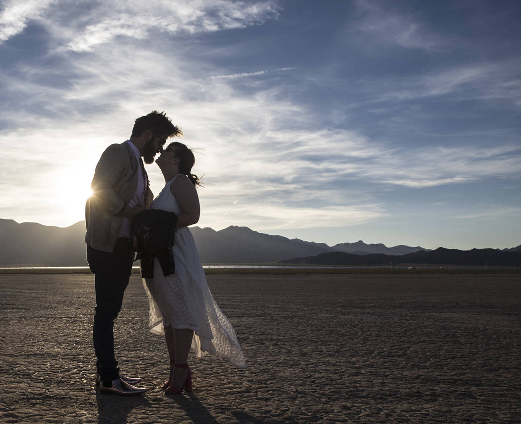 Joe Brown, left, and Shannon Bray celebrate at the conclusion of their popup wedding ceremony  on Tuesday, June 6, 2017, at El Dorado Dry Lake Bed, outside Boulder City. Flora Pop owner Victoria H ...