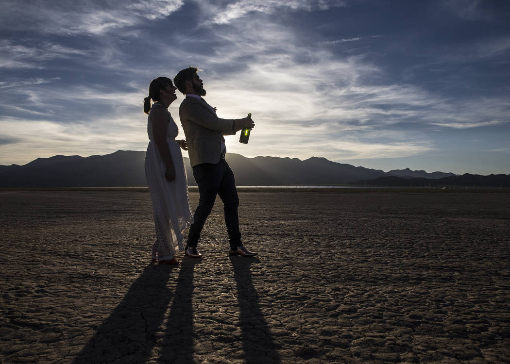 Joe Brown, right, and Shannon Bray celebrate at the conclusion of their popup wedding ceremony  on Tuesday, June 6, 2017, at El Dorado Dry Lake Bed, outside Boulder City. Flora Pop owner Victoria  ...