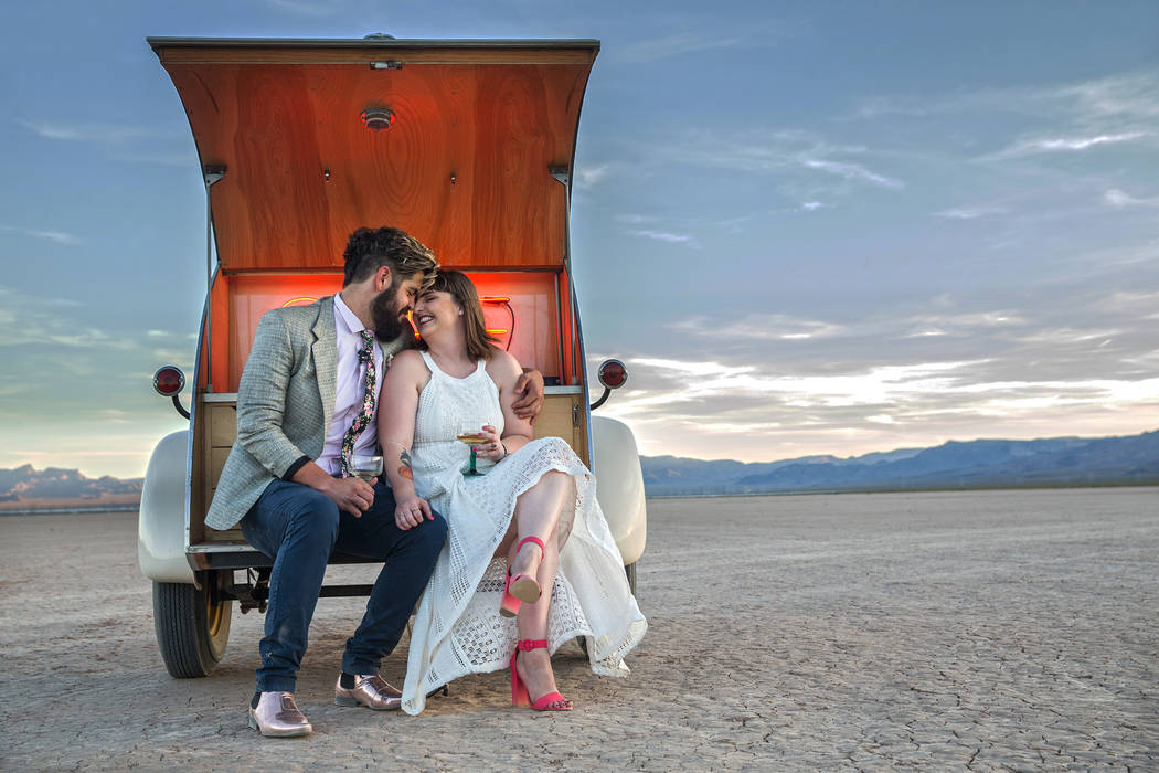 Joe Brown, left, and Shannon Bray celebrate at the conclusion of their popup wedding ceremony on Tuesday, June 6, 2017, at El Dorado Dry Lake Bed, outside Boulder City. Flora Pop owner Victoria Ho ...