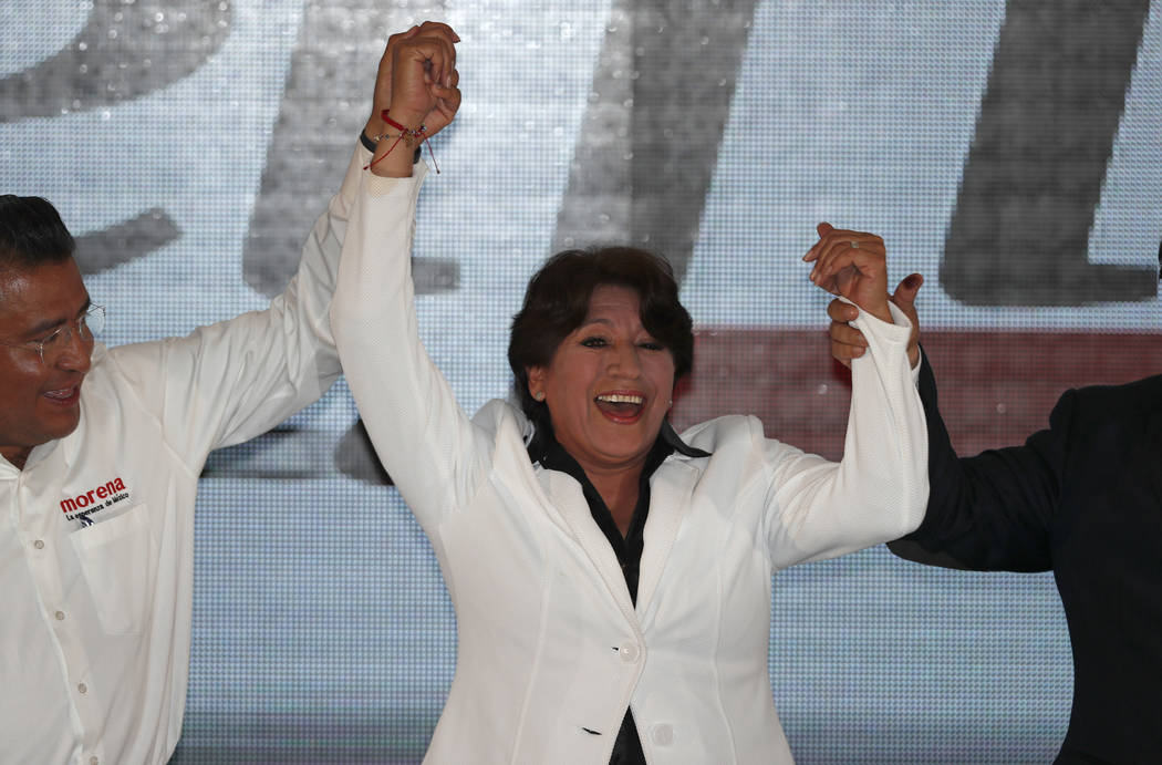 Schoolteacher-turned-politician and Mexico state gubernatorial candidate for the National Regeneration Movement, or MORENA, Delfina Gomez greets supporters at her party's headquarters in Toluca, M ...