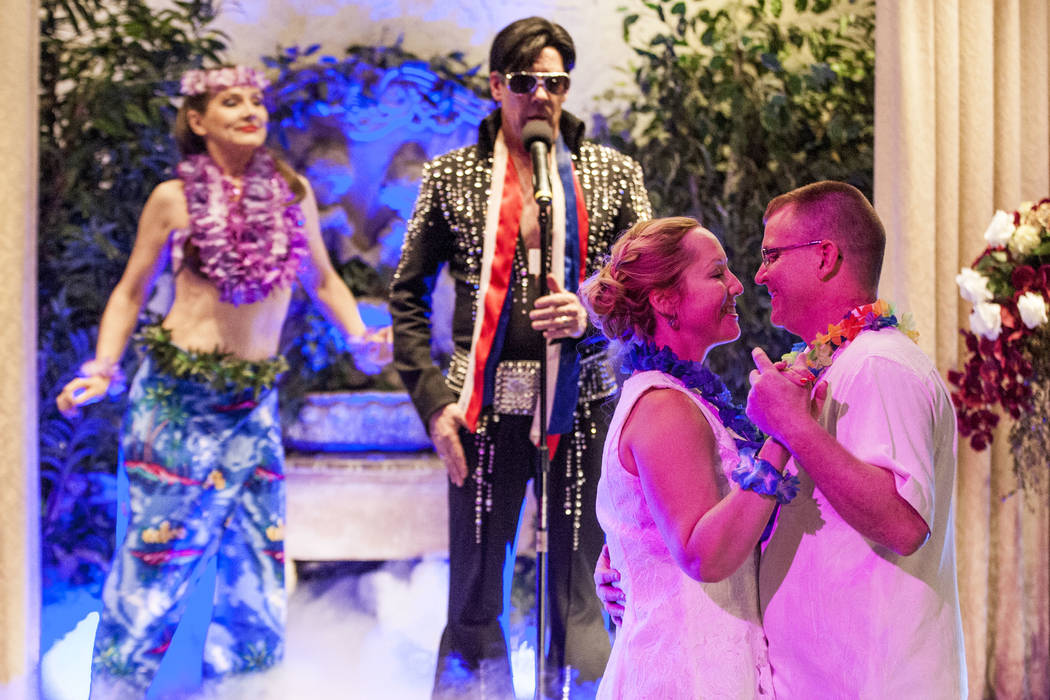 Ron Decar, owner of Viva Las Vegas, makes his appearance as Elvis as Missie Berry and Robert Moseley renew their wedding vows at the Viva Las Vegas Wedding Chapel on Saturday, June 3, 2017.  Patri ...