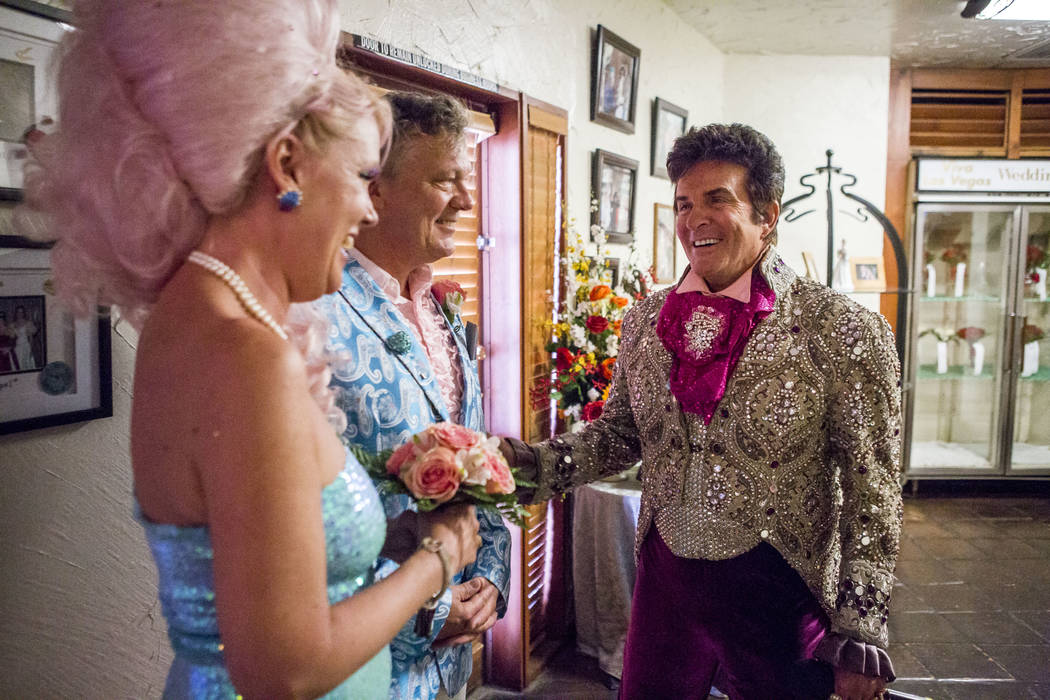 Liberace greets Andrea Cambridge and Chuck Varga before their wedding ceremony at the Viva Las Vegas Wedding Chapel on Saturday, June 3, 2017.  Patrick Connolly Las Vegas Review-Journal @PConnPie