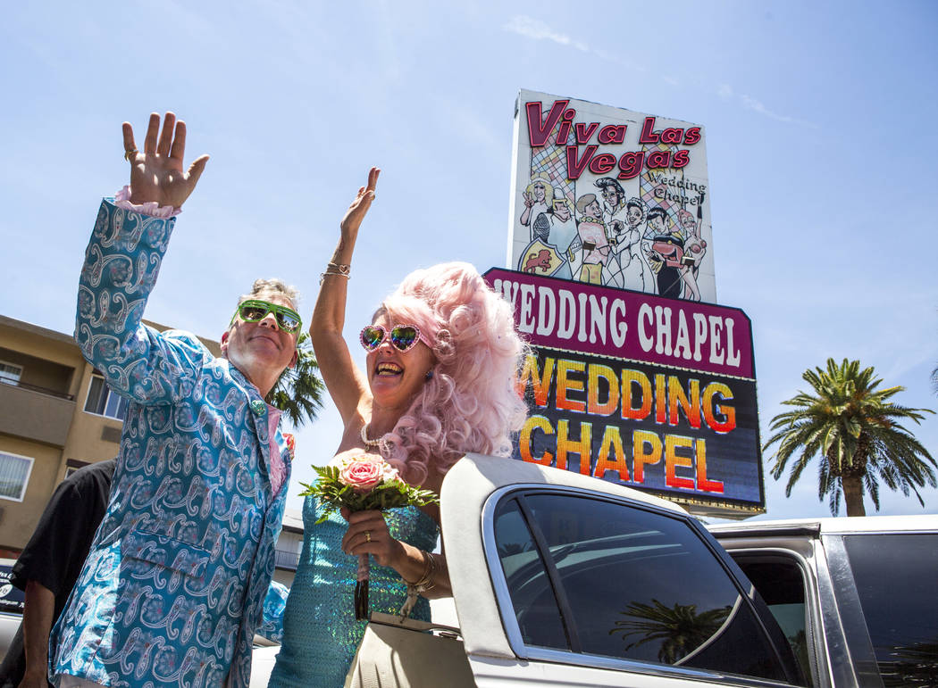 Andrea Cambridge and Chuck Varga wave goodbye to wedding guests after their Liberace-themed wedding at the Viva Las Vegas Wedding Chapel on Saturday, June 3, 2017.  Patrick Connolly Las Vegas Revi ...