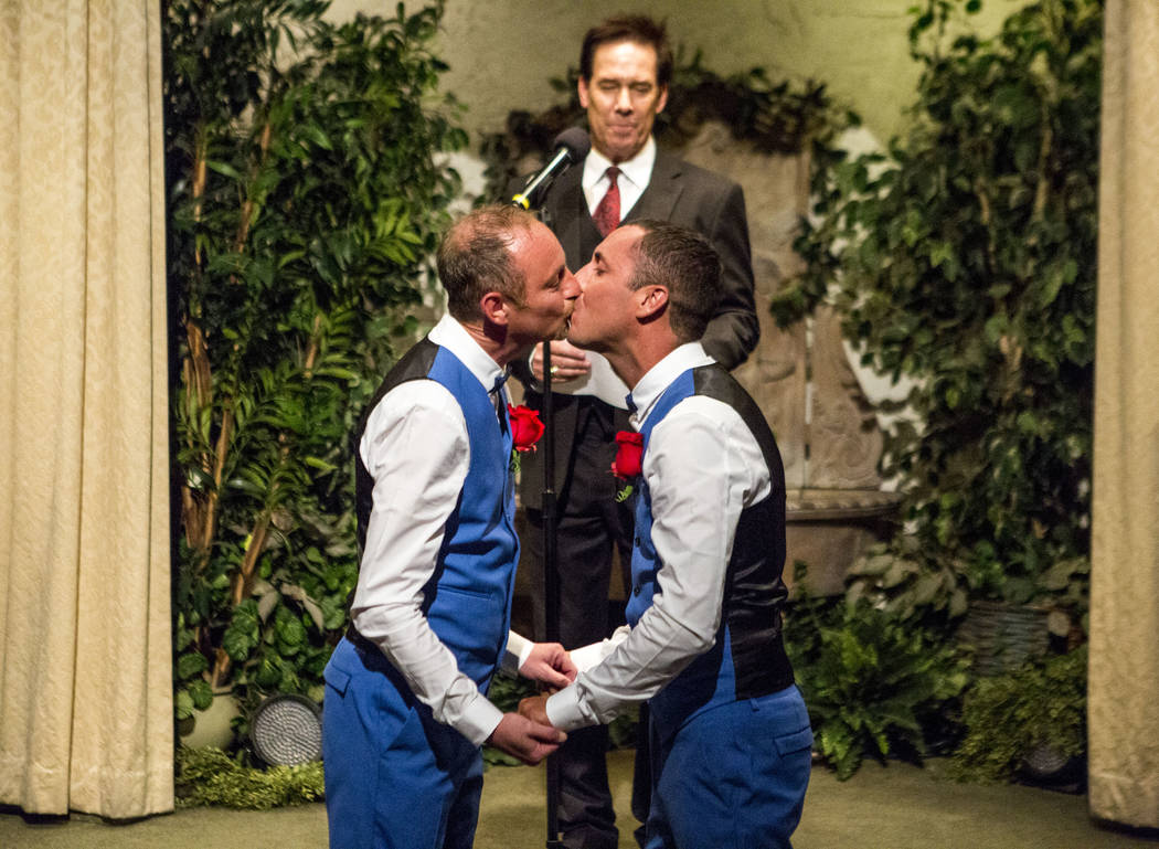 Lee McCulloch, right, and Stuart Dootson of Folkstone, England, kiss during their wedding at the Viva Las Vegas Wedding Chapel on Saturday, June 3, 2017.  Patrick Connolly Las Vegas Review-Journal ...