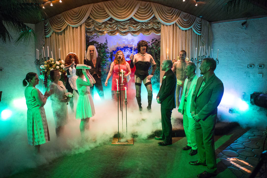 "The song ""There's A Light (Over At The Frankenstein Place)"" plays during the Rocky Horror Picture Show wedding of Alex Spivak and Dominique Lehn at the Viva Las Vegas Wedding Cha ..."