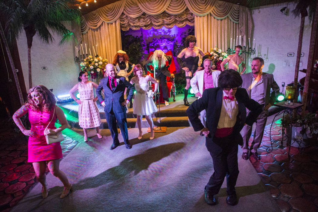 "Wedding guests and actors dance to ""The Time Warp"" during the Rocky Horror Picture Show wedding of Alex Spivak and Dominique Lehn at the Viva Las Vegas Wedding Chapel on Saturday ..."