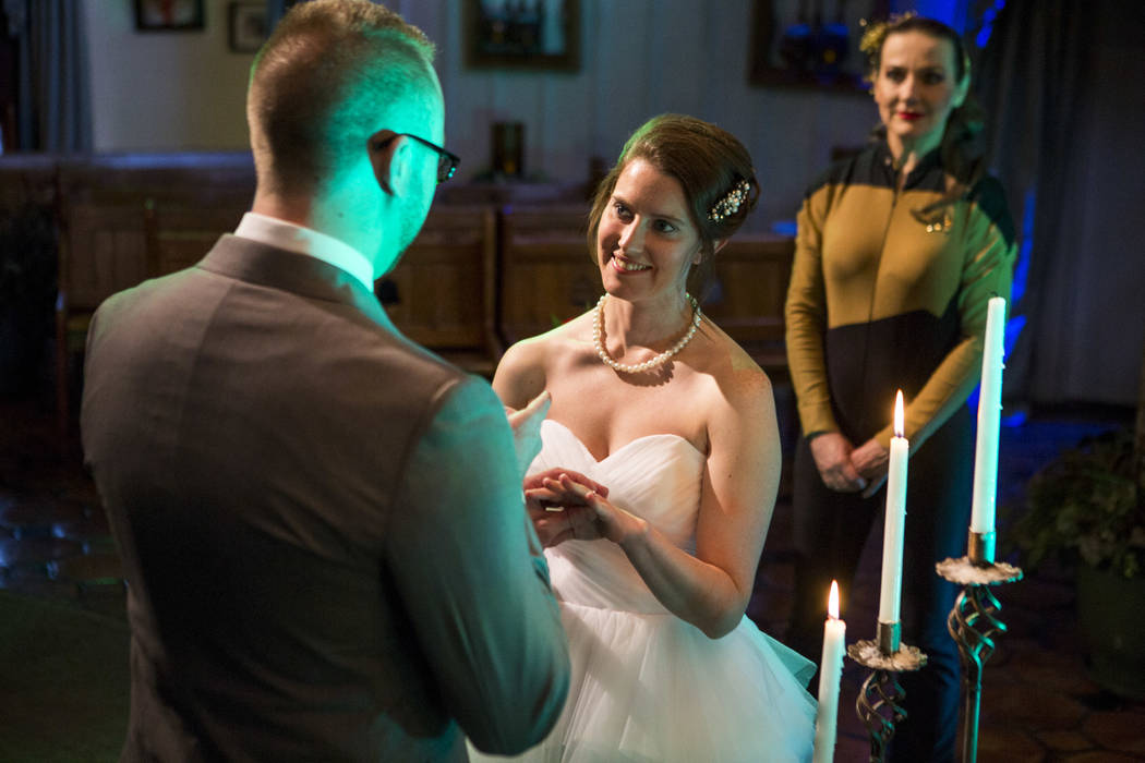 Stephen Goetz puts a ring on the finger of his new wife, Kristin Perry, during their Star Trek-themed wedding of at the Viva Las Vegas Wedding Chapel on Saturday, June 3, 2017.  Patrick Connolly L ...