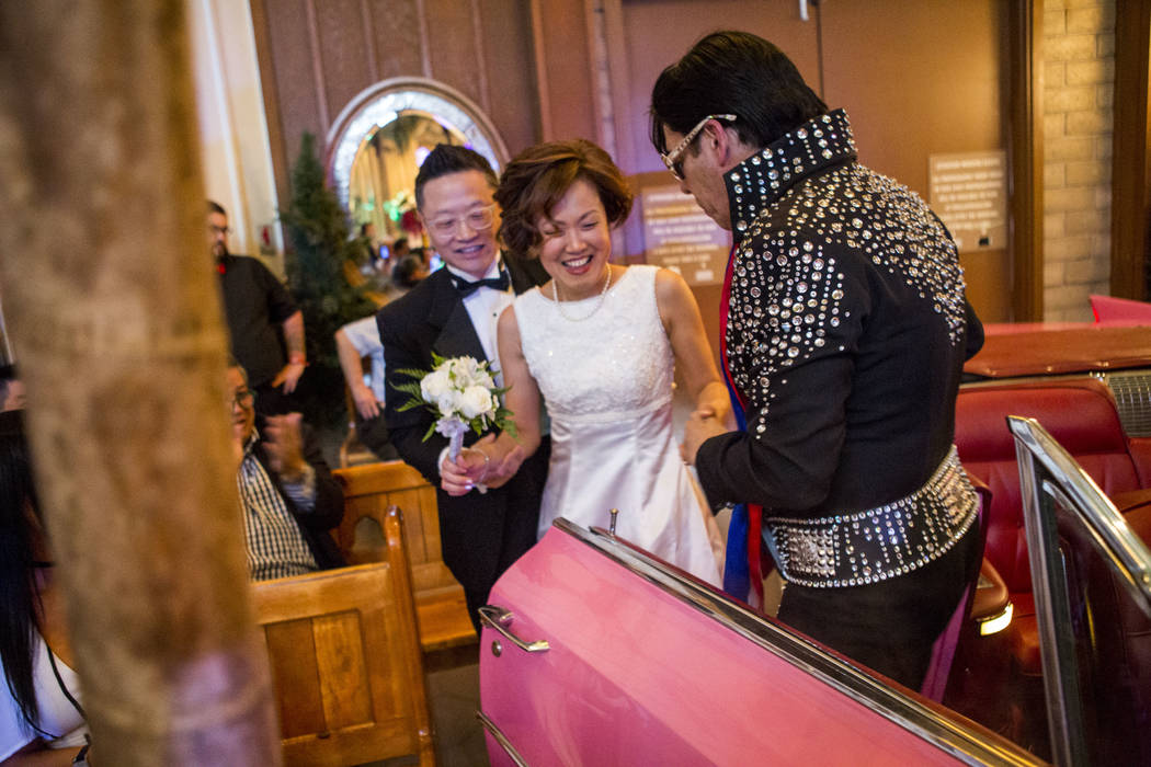 Ron Decar, owner of Viva Las Vegas, helps Julie and Garry Kim out of the pink Cadillac and into the chapel to renew their wedding vows at the Viva Las Vegas Wedding Chapel on Saturday, June 3, 201 ...