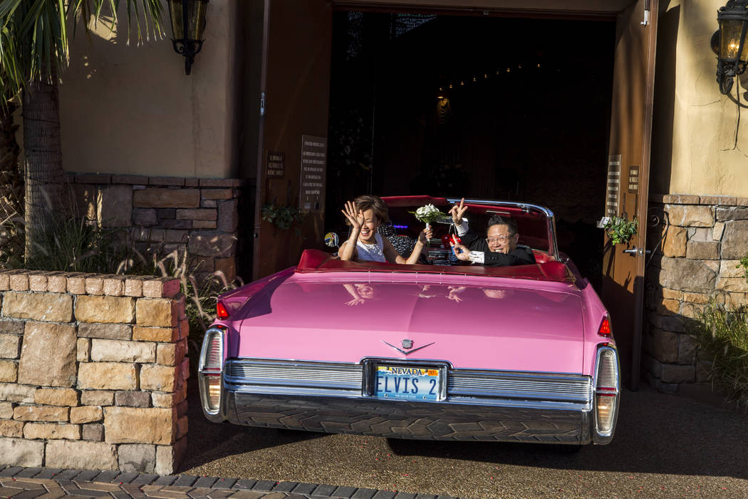 Garry and Julie Kim leave the chapel in a pink Cadillac after renewing their wedding vows at the Viva Las Vegas Wedding Chapel on Saturday, June 3, 2017.  Patrick Connolly Las Vegas Review-Journal ...