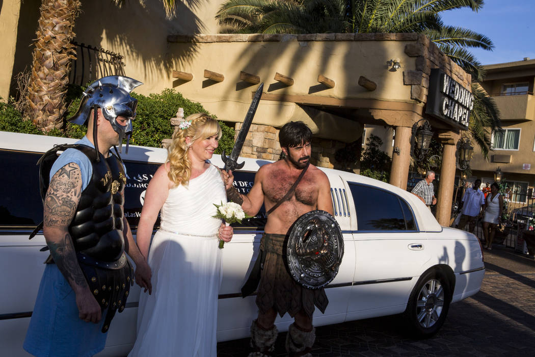 Amanda Gancedo and Marcos Gonzalez of Oviedo, Spain, take photos after their gladiator-themed wedding at the Viva Las Vegas Wedding Chapel on Saturday, June 3, 2017.  Patrick Connolly Las Vegas Re ...