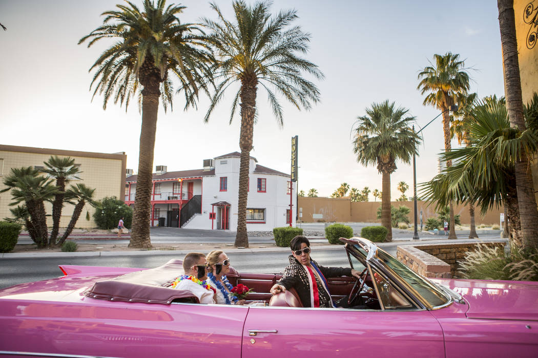 Ron Decar, owner of Viva Las Vegas and dressed as Elvis, drives Missie Berry and Robert Moseley into the chapel to renew their wedding vows at the Viva Las Vegas Wedding Chapel on Saturday, June 3 ...