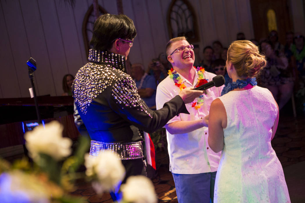 Missie Berry and Robert Moseley share a moment as they renew their wedding vows during an Elvis-themed ceremony at the Viva Las Vegas Wedding Chapel on Saturday, June 3, 2017.  Patrick Connolly La ...