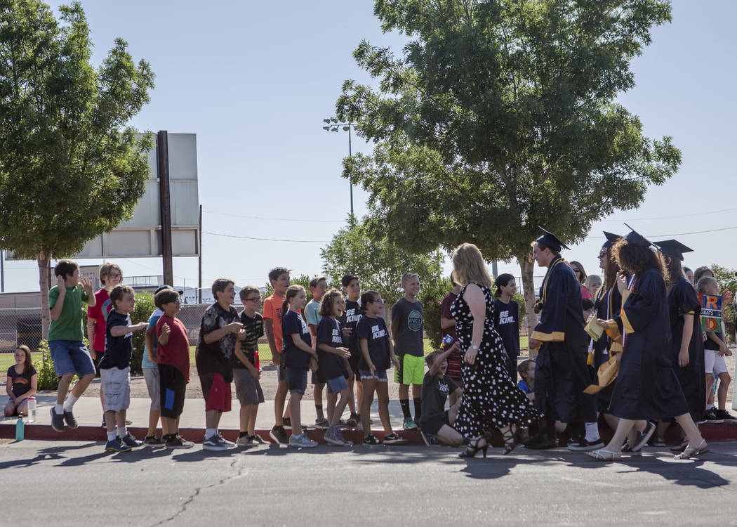 Boulder City High School seniors greet elementary schoolers in an annual Grad Walk to celebrate the seniors' accomplishments and encourage young students to finish high school on Monday, June 5, 2 ...
