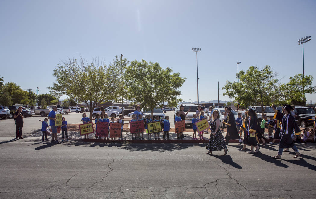 Boulder City High School seniors walk in an annual Grad Walk to celebrate the seniors' accomplishments and encourage young students to finish high school on Monday, June 5, 2017. (Patrick Connolly ...
