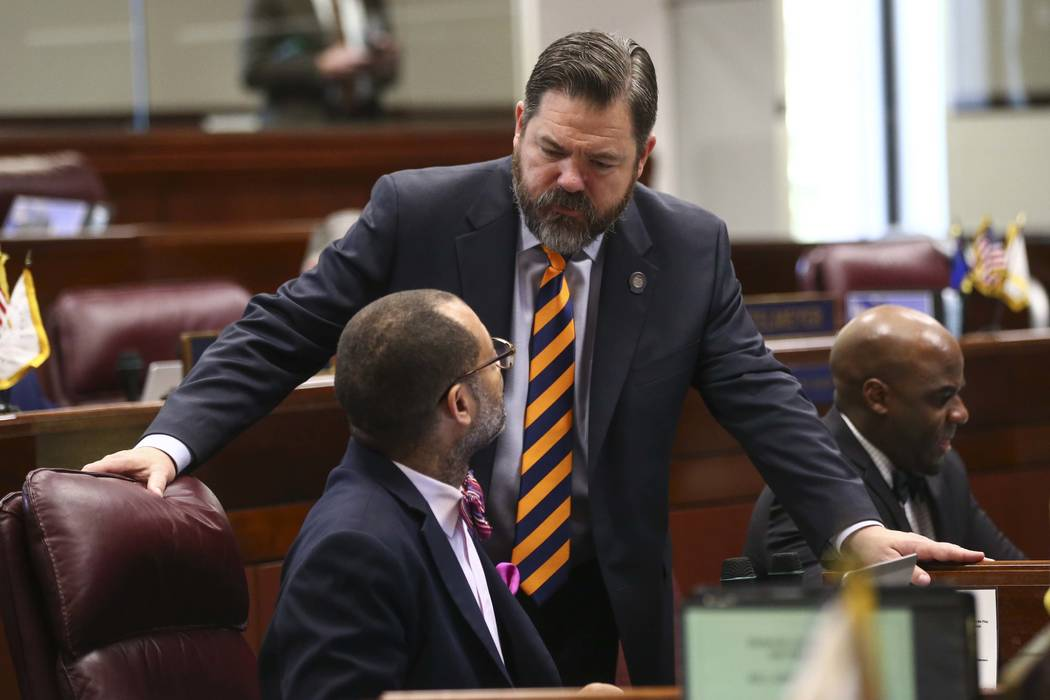 Senate Majority Leader Aaron Ford, D-Las Vegas, left, talks with Senate Minority Leader Michael Roberson, R-Henderson, during the last day of the Nevada Legislature at the Legislative Building in  ...