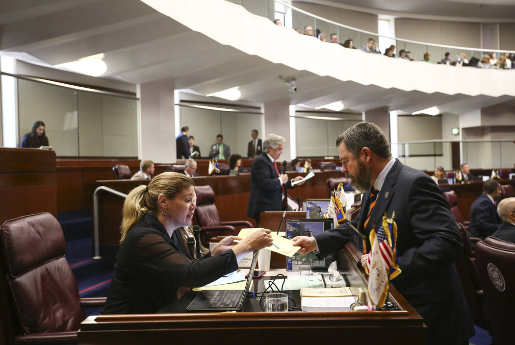 Sen. Patricia Farley, I-Las Vegas, left, talks with Senate Minority Leader Michael Roberson, R-Henderson, during the last day of the Nevada Legislature at the Legislative Building in Carson City o ...