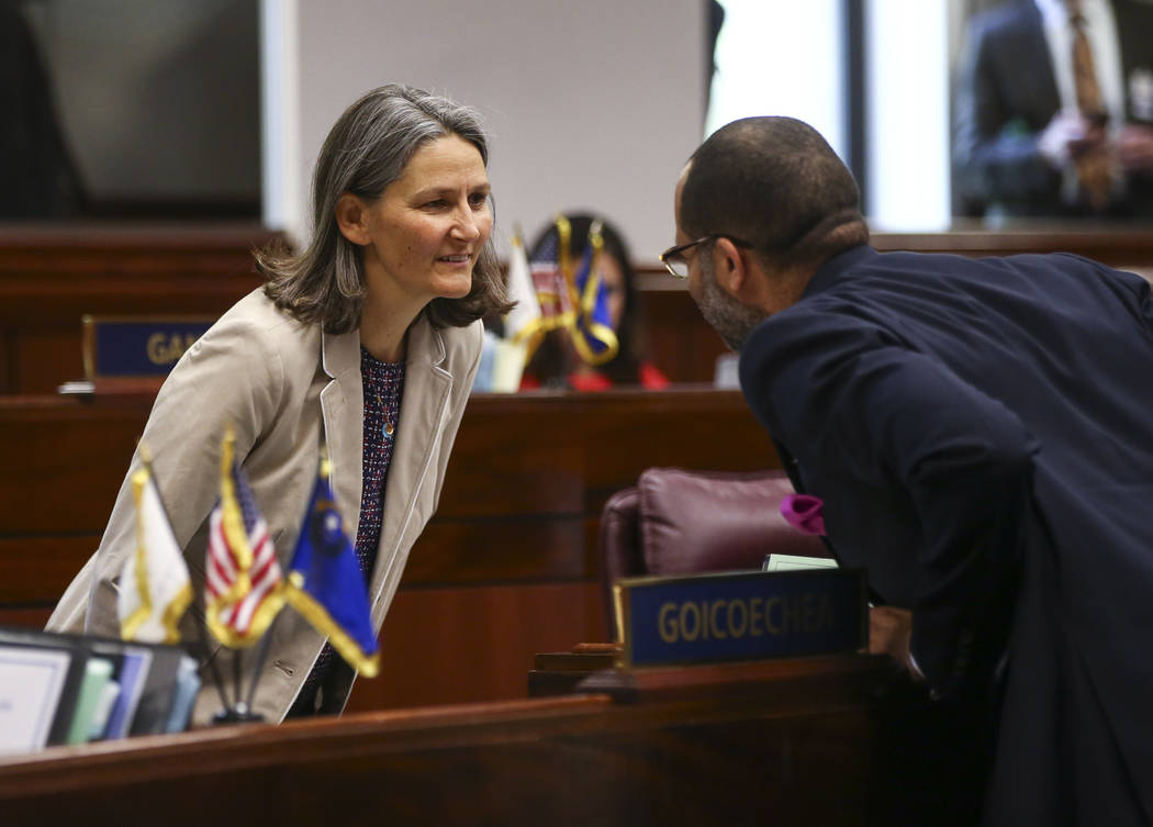 Sen. Julia Ratti, D-Sparks, left, talks with Senate Majority Leader Aaron Ford, D-Las Vegas, during the last day of the Nevada Legislature at the Legislative Building in Carson City on Monday, Jun ...