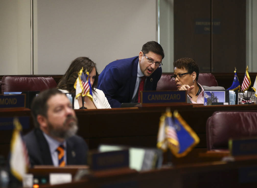 Sen. Mark Manendo, D-Las Vegas, center, talks with Sen. Pat Spearman, D-North Las Vegas, during the last day of the Nevada Legislature at the Legislative Building in Carson City on Monday, June 5, ...