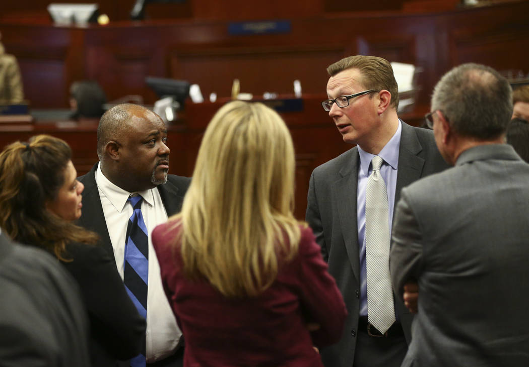 Assembly Speaker Jason Frierson, D-Las Vegas, second from left, and Sen. Ben Kieckhefer, R-Reno, fourth from left, in the Assembly Chambers at the Legislative Building in Carson City during the ea ...