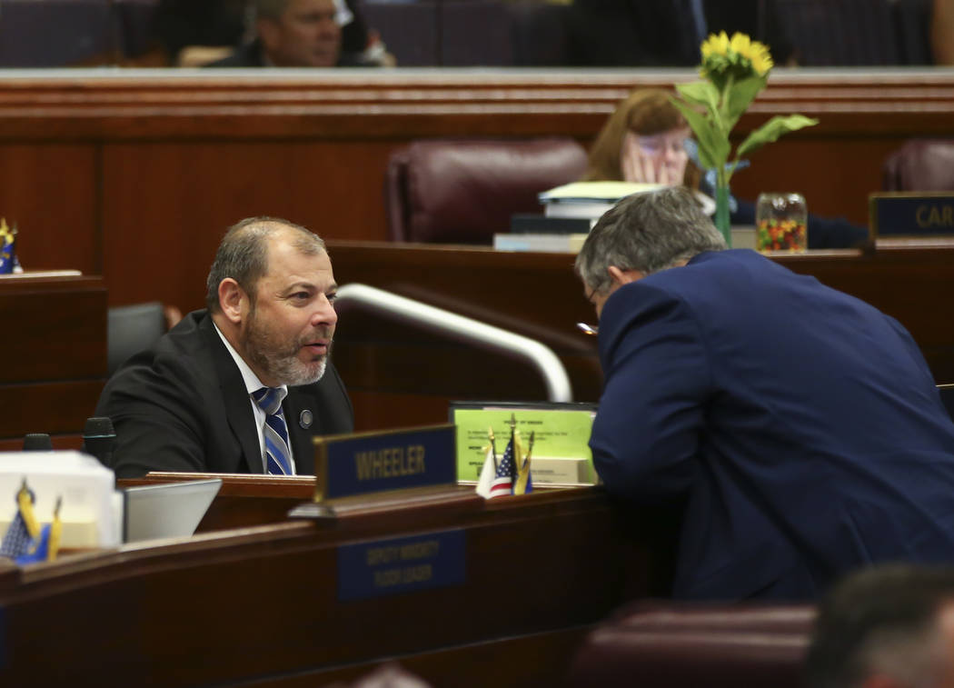Assembly Minority Floor Leader Paul Anderson, R-Las Vegas, left, and Assemblyman James Oscarson, R-Pahrump, during the last day of the Nevada Legislature at the Legislative Building in Carson City ...