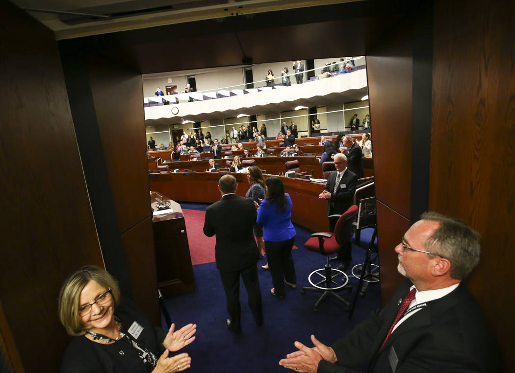 Members of the Nevada Assembly, from center left, Assembly Minority Floor Leader Paul Anderson, R-Las Vegas, Assembly Majority Floor Leader Teresa Benitez-Thompson, D-Reno, and Irene Bustamante Ad ...