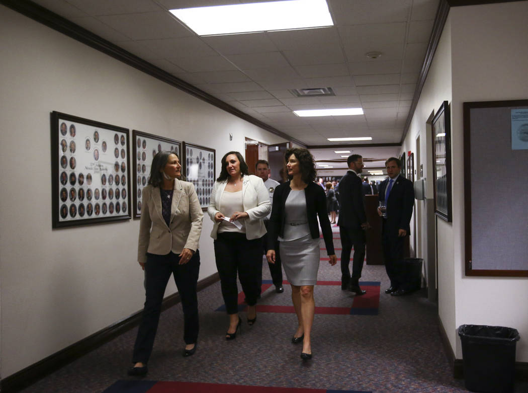 Nevada senators, from left, Julia Ratti, D-Sparks, Nicole Cannizzaro, D-Las Vegas, and Heidi Gansert, R-Reno, make their way to the Assembly chambers to deliver the message to end the session duri ...