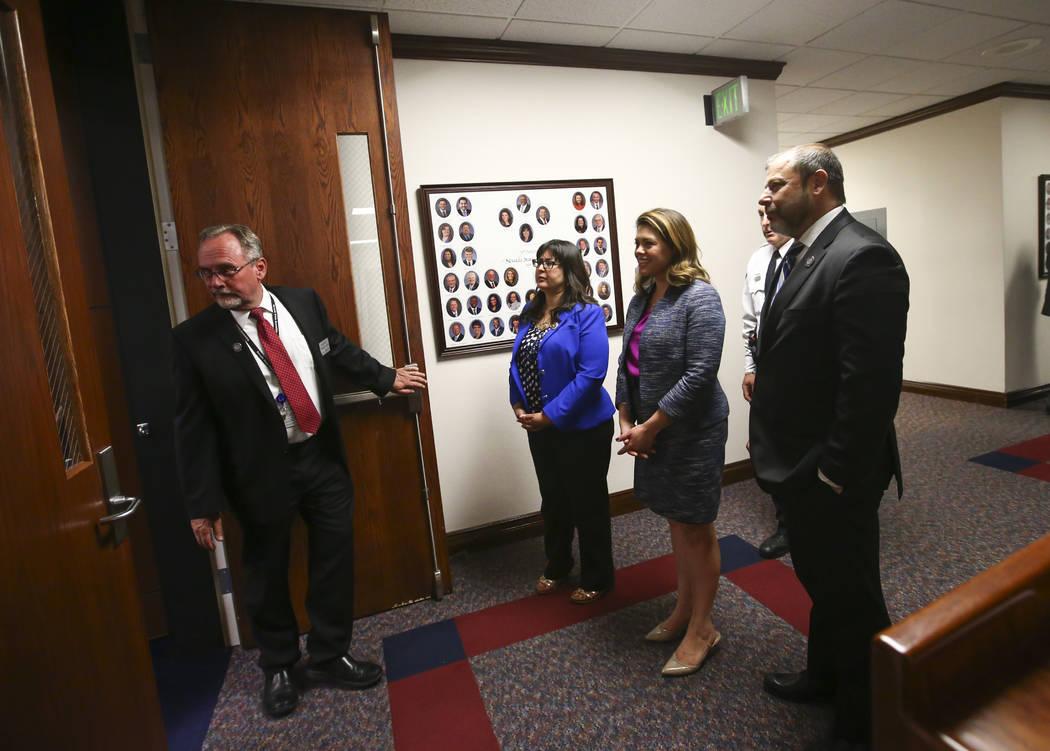 Members of the Nevada Assembly, from center left, Irene Bustamante Adams, D-Las Vegas, Assembly Majority Floor Leader Teresa Benitez-Thompson, D-Reno, and Assembly Minority Floor Leader Paul Ander ...