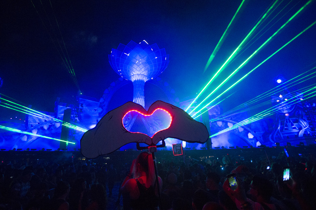 A light up heart sign is displayed by a crowd member at kineticFIELD during the second evening of Electric Daisy Carnival at Las Vegas Motor Speedway in the early hours of Sunday, June 19, 2016. ( ...