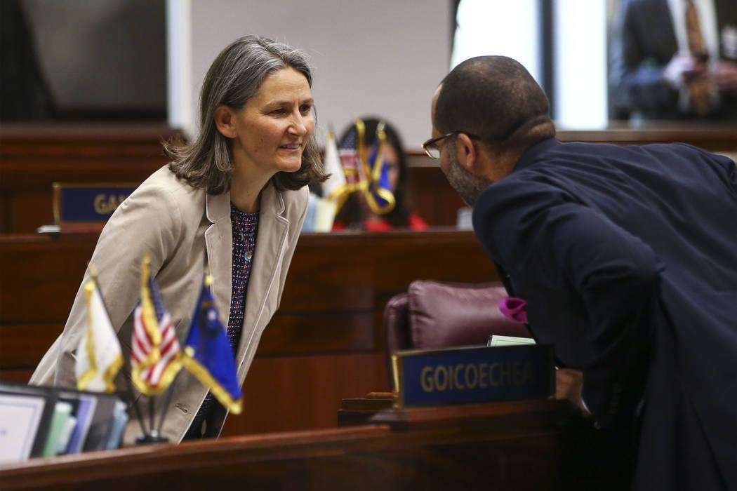 Sen. Julia Ratti, D-Sparks, left, talks with Senate Majority Leader Aaron Ford, D-Las Vegas, during the last day of the Nevada Legislature at the Legislative Building in Carson City on Monday, Jun ...