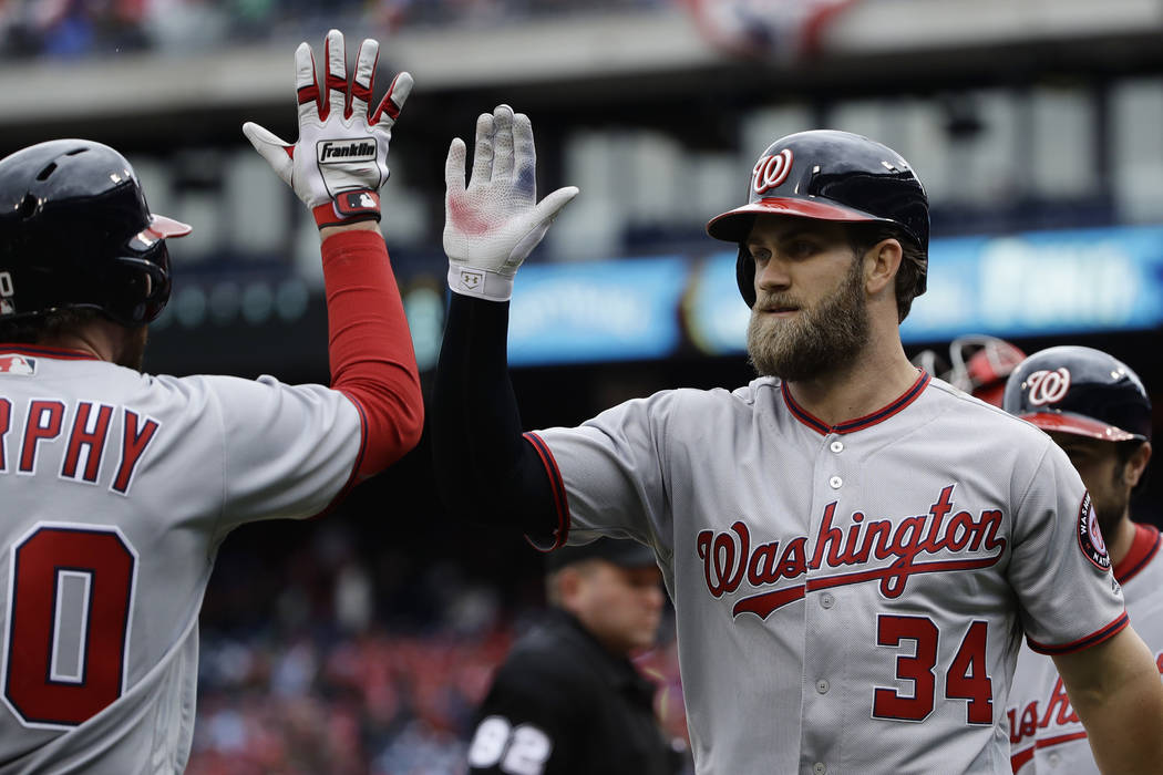 Washington outfielder and Las Vegas native Bryce Harper (34) celebrates with teammate Daniel Murphy after hitting a two run home run in the first inning against the Phillies in Philadelphia on Fri ...