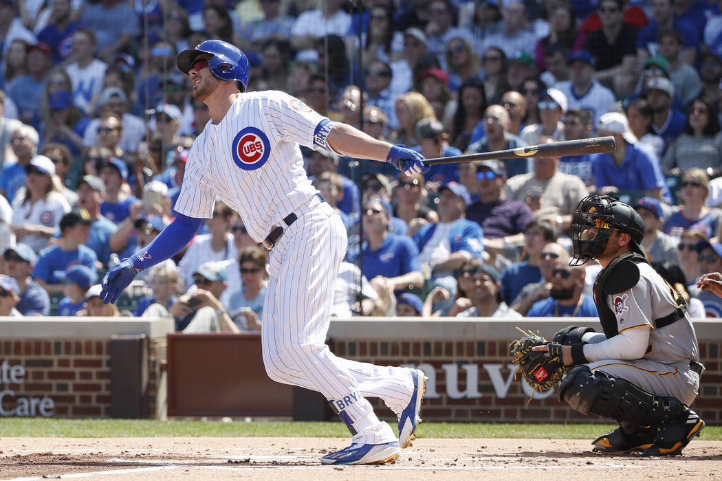 Chicago Cubs third baseman Kris Bryant hits a two-run home run off Pittsburgh Pirates starting pitcher Tyler Glasnow during the first inning of a baseball game, Saturday, April 15, 2017, in Chicag ...