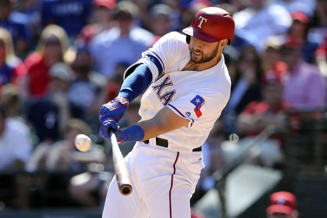 Apr 23, 2017; Arlington, TX, USA; Texas Rangers third baseman Joey Gallo (13) hits a home run during the sixth inning against the Kansas City Royals at Globe Life Park in Arlington. (Kevin Jairaj/ ...