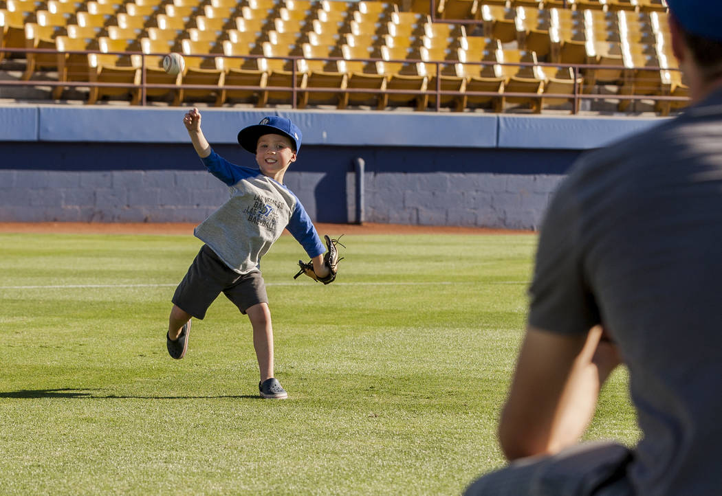Dillon Truman, 4, throws the ball to his father Jared during father and child catch, an annual tradition, before the Las Vegas 51s game at Cashman Field on Friday, June 16, 2017.  Patrick Connolly ...