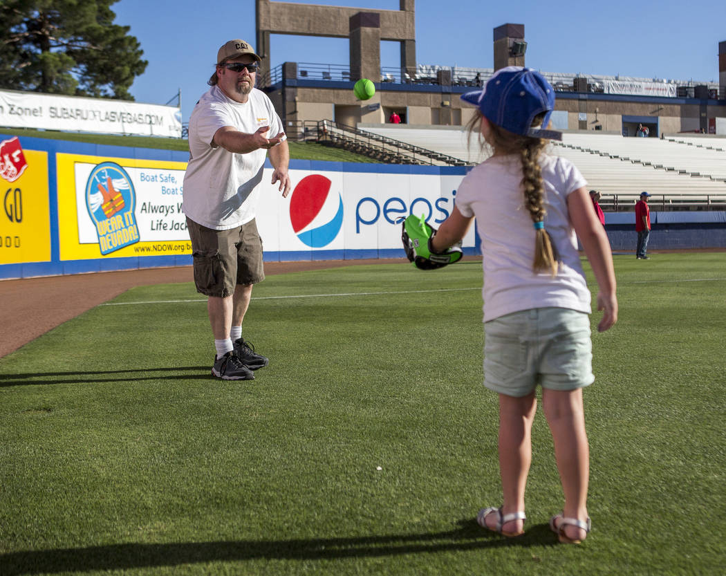 Bill Houck throws the ball to his daughter Addi, 5, during father and child catch, an annual tradition, before the Las Vegas 51s game at Cashman Field on Friday, June 16, 2017.  Patrick Connolly L ...