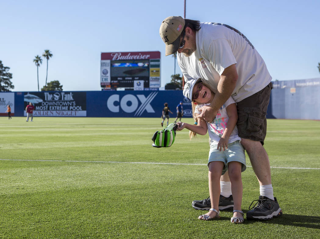 Bill Houck shares a moment with his daughter Addi, 5, during father and child catch, an annual tradition, before the Las Vegas 51s game at Cashman Field on Friday, June 16, 2017.  Patrick Connolly ...