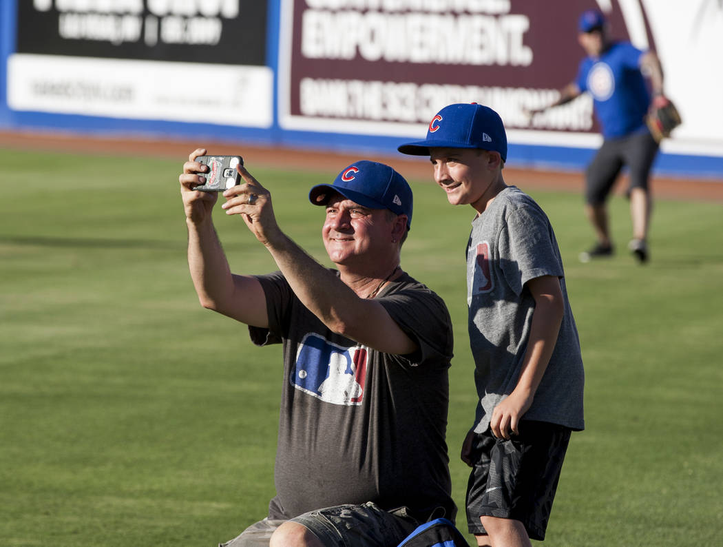 Harold Christensen, left, and his son Gavin, 9, take a selfie after father and child catch, an annual tradition, before the Las Vegas 51s game at Cashman Field on Friday, June 16, 2017.  Patrick C ...