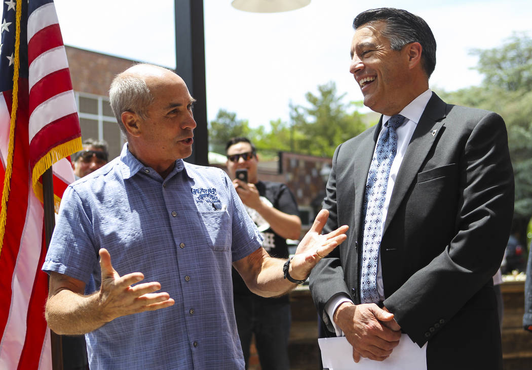 Tom Young, owner of Great Basin Brewing Company, left, talks before Gov. Brian Sandoval signs Assembly Bill 431 at The Union restaurant and brewery in Carson City on Monday, June 5, 2017. The bill ...