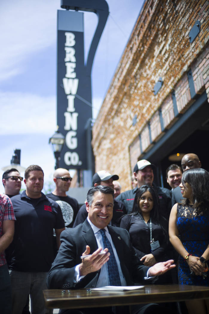 Gov. Brian Sandoval talks about Assembly Bill 431 before signing it at The Union restaurant and brewery in Carson City on Monday, June 5, 2017. The bill nearly triples the number of barrels a craf ...