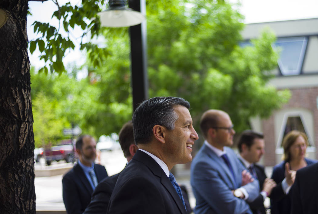 Gov. Brian Sandoval arrives to sign Assembly Bill 431 at The Union restaurant and brewery in Carson City on Monday, June 5, 2017. The bill nearly triples the number of barrels a craft brewery or b ...
