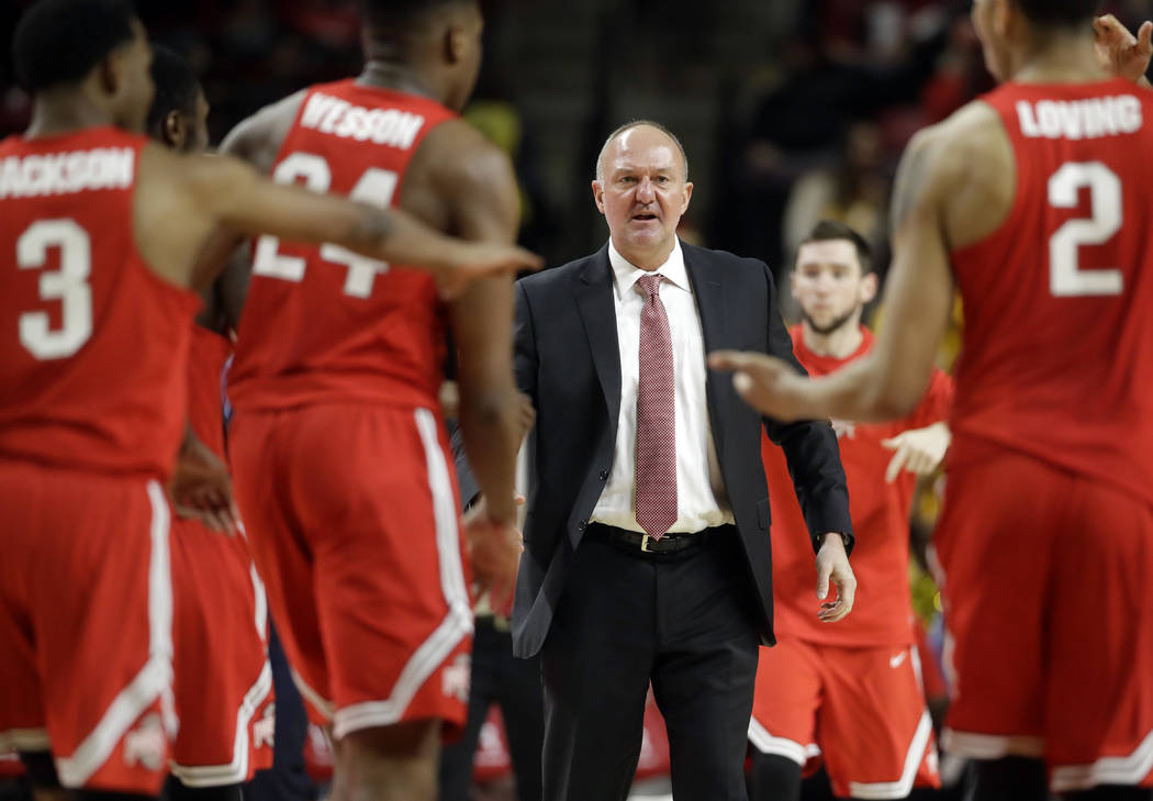FILE - In this Feb. 11, 2017, file photo, Ohio State head coach Thad Matta, center, looks toward Ohio State guard C.J. Jackson (3), forward Andre Wesson (24) and forward Marc Loving (2) during a t ...