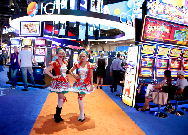 Models stand in the International Game Technology booth  during the Global Gaming Expo at the Las Vegas Sands Expo and Convention Center on Thursday , Sept. 29, 2016. Las Vegas Review-Journal file ...