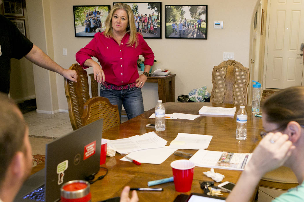Las Vegas Ward 6 city council candidate Kelli Ross talks voting numbers with friends and campaign workers during a watch party at her home on Tuesday, June 13, 2017 in Las Vegas. Bridget Bennett L ...
