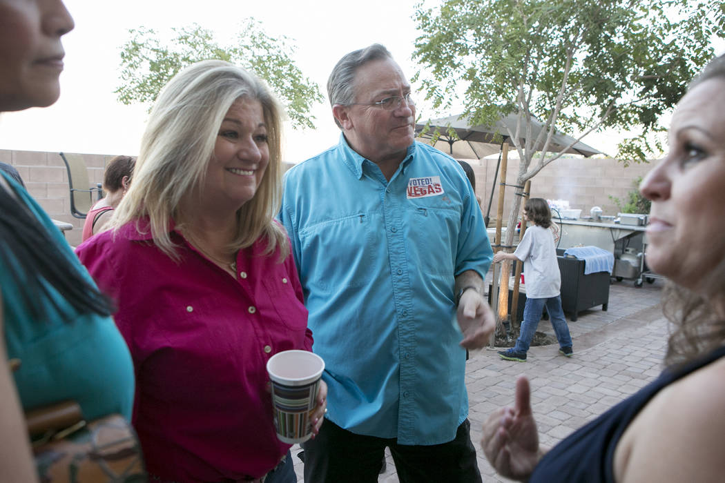 Las Vegas Ward 6 city council candidate Kelli Ross, left, and husband Steve Ross, who currently represents Ward 6, right, entertain family, friends and campaign workers during a watch party at the ...