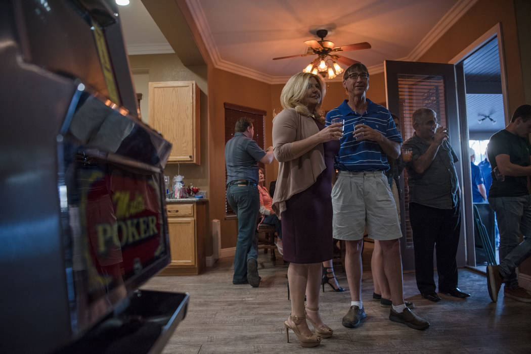 Las Vegas City Council Ward 6 candidate Michele Fiore and John Sheehan look towards the television during her election night party in her home on Tuesday, June 13, 2017 in Las Vegas.  Morgan Liebe ...