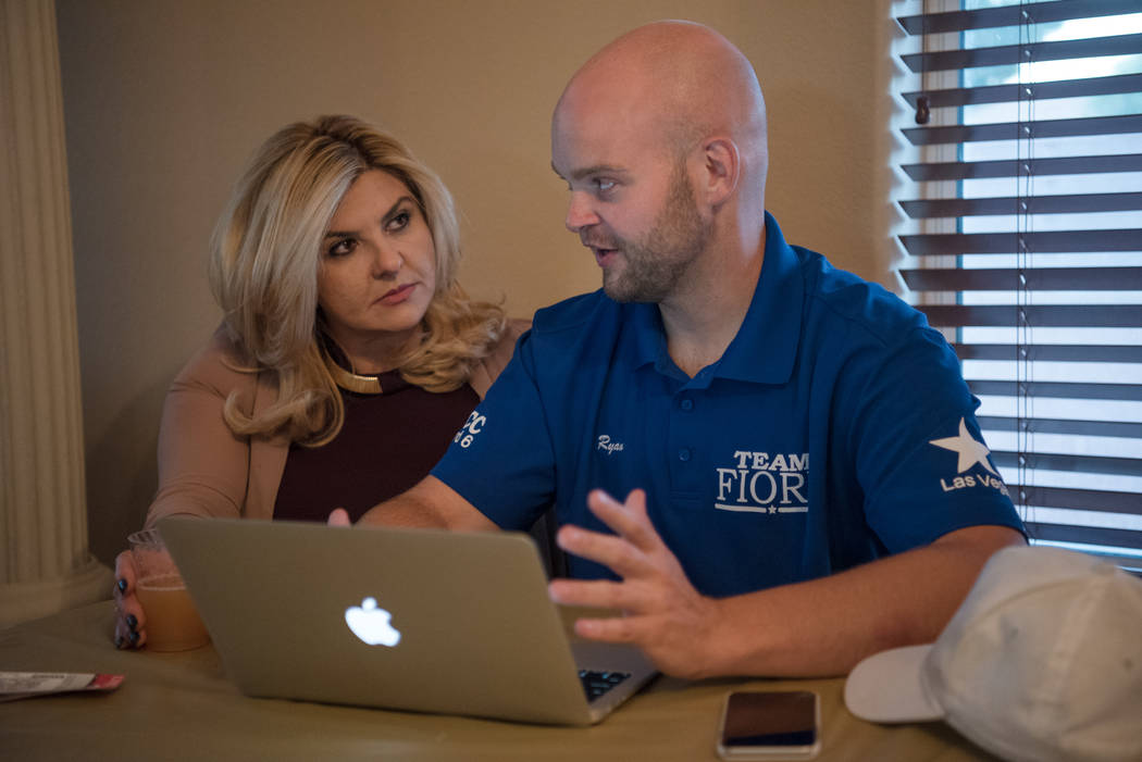 Las Vegas City Council Ward 6 candidate Michele Fiore talks with Ryan Hamilton, senior campaign advisor, about early voting numbers at her home in Las Vegas on Tuesday, June 13, 2017. Morgan Liebe ...