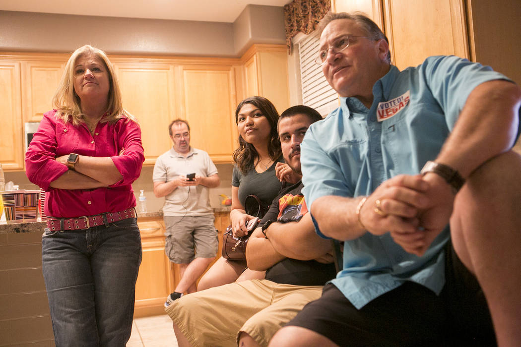 Las Vegas Ward 6 City Council candidate Kelli Ross, left, watches voting results roll in during a watch party at her home on Tuesday, June 13, 2017 in Las Vegas. Bridget Bennett Las Vegas Review-J ...
